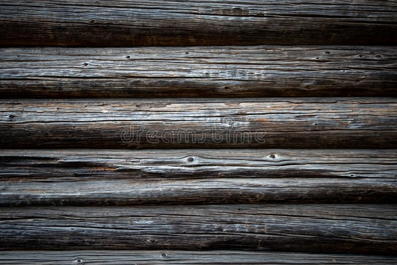 Dark old log wood wall of house stock photography