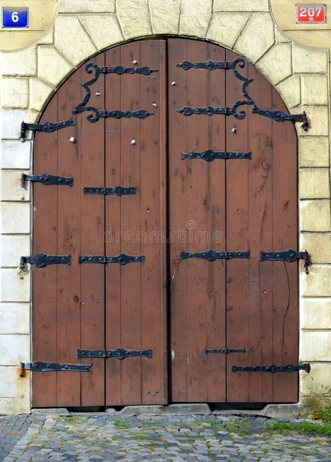 Old wood and metal iron closed door, Prague royalty free stock photo