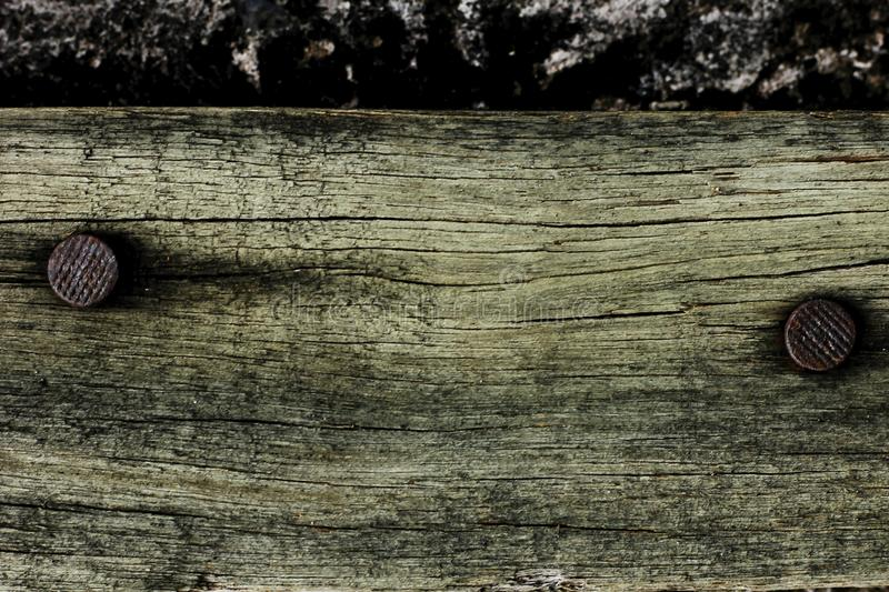 Old wood with nails to rust. stock image