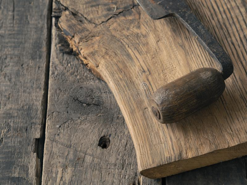 Old wood plane on oak plank stock photo