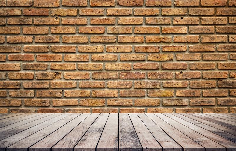 Old wood plank with abstract old brick wall background stock photo