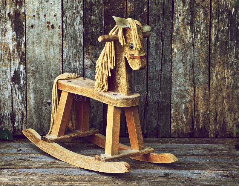 Old wood rocking horse on wood. stock photos