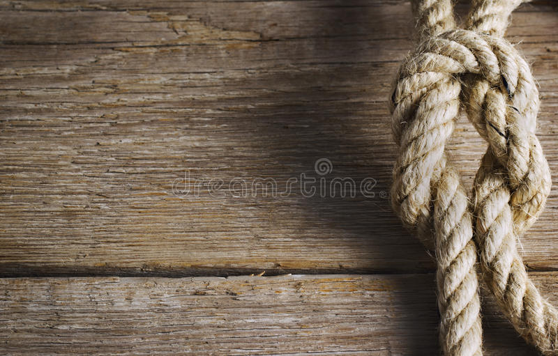 Old wood with rope knot stock photo