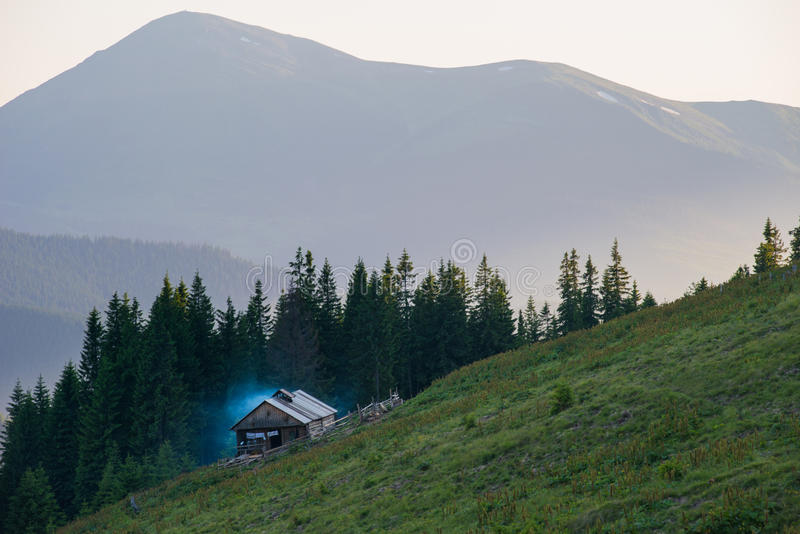 Old wood shack. Mountain valley and old wood shack in the mountains stock photo