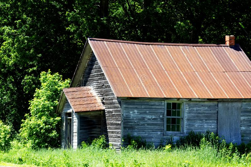 Old wood shack by the woods. In the country on a sunny day royalty free stock photos