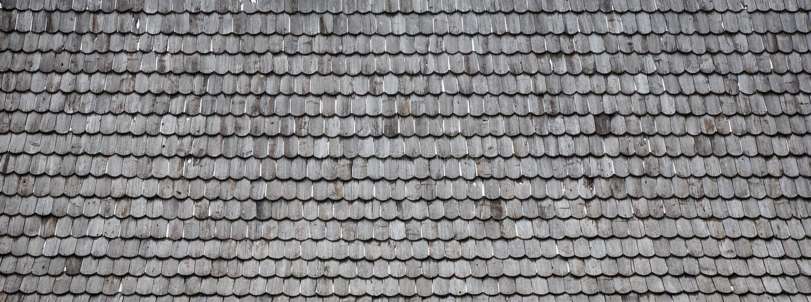 Old wood shingle roof background. Old wood shingle roof with rough surface, background stock photography