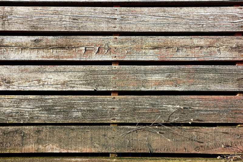 Old Wood Slat Sidewalk Boardwalk in Antique Town. Old wood slat boards walking sidewalk pedestrian walk made of weathered wooden planks in an antique rural town stock photo