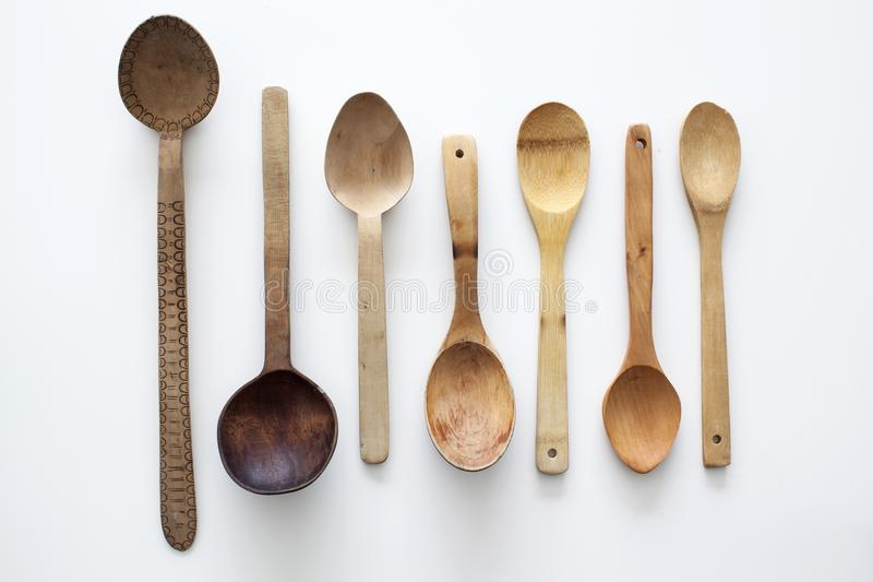 Old wood spoon on white background stock photo