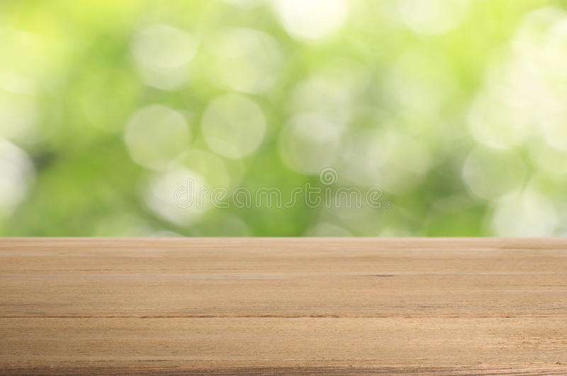 Old wood table on abstract green background. royalty free stock photo