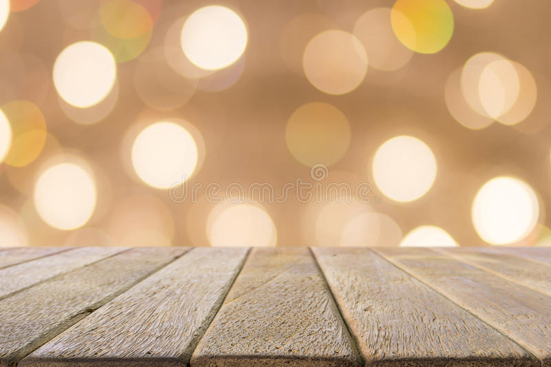 Old wood table on abstract orange background. royalty free stock photography