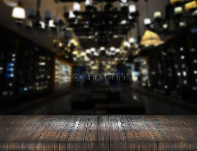Old wood table counter on blur night club royalty free stock photo