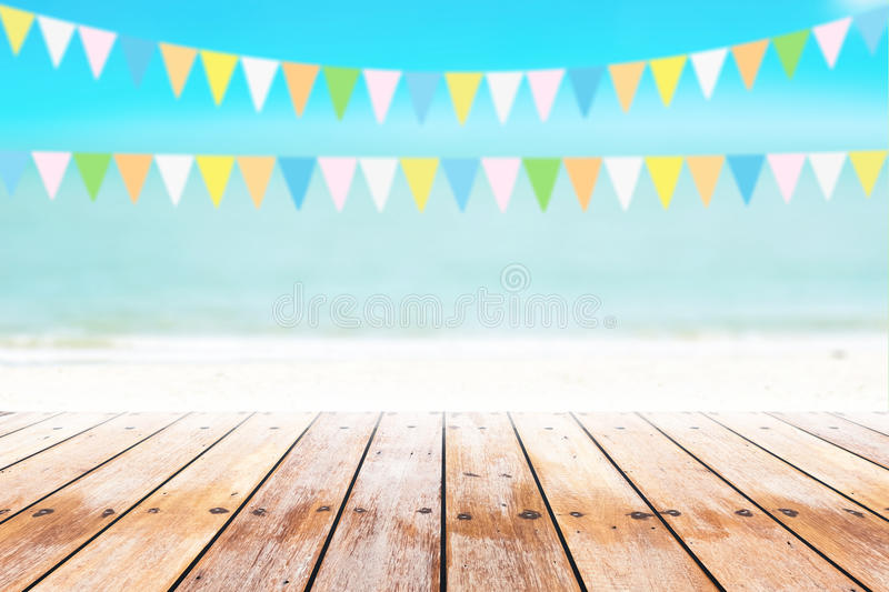 Old wood table top on blurred beach background with coconut leaf stock images