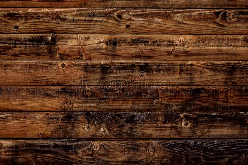 Old wood texture background. Dark brown wooden boards, planks. Surface of dark shabby weathered parquet, desk. Vintage pattern of stock photos