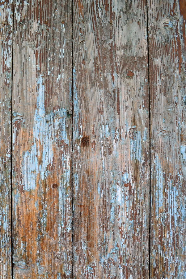 Old wood texture cracked with peeled blue tourquoise paint royalty free stock photography