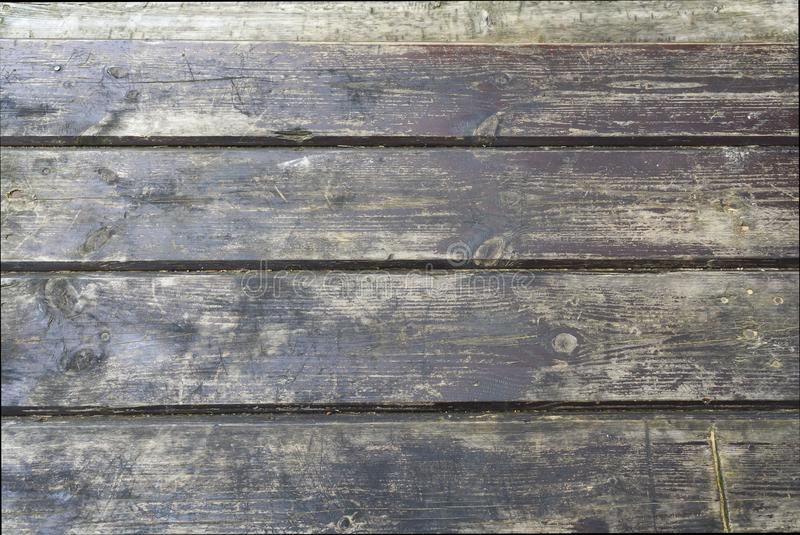 The old wood texture with natural patterns. dark wood board use for background royalty free stock image