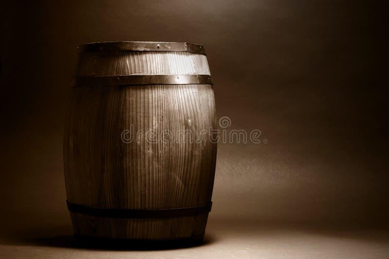 Old Wood Whisky or Wine Barrel in Vintage Sepia. Old antique decorative wood whisky or wine barrel cask container in nostalgic vintage sepia stock image
