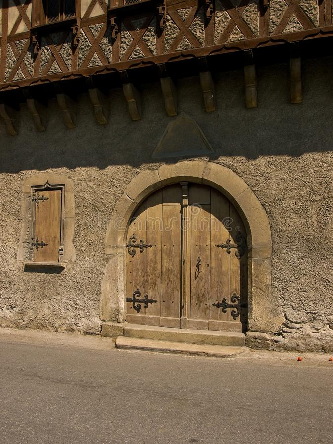 Old wooden arch door in Arreau, France. royalty free stock photos