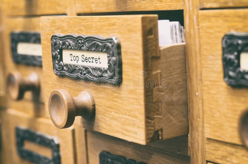 Old wooden archive files catalog drawer, Top Secret files stock photo