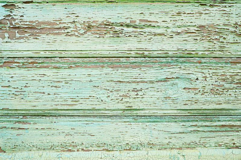 Old wooden background with cracks painted green. Rustic wood texture. stock photography