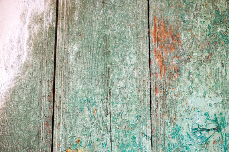 Old wooden background with green rippled paint. vintage wood texture stock image
