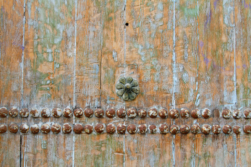 Old wooden background with metal rivets and flower. Old wooden background or texture with metal rivets and flower royalty free stock images