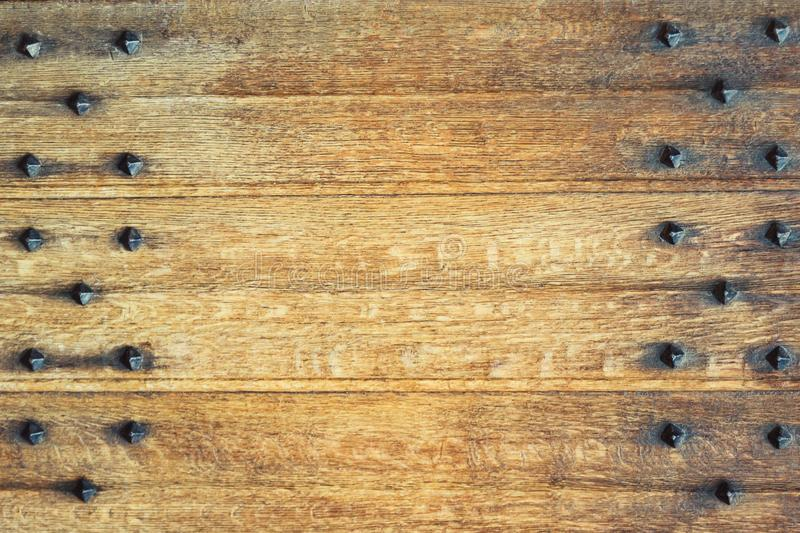 Old wooden background with metal rivets. Vintage wooden doors. Details royalty free stock photos