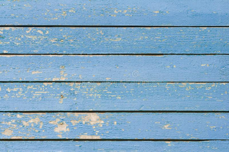 An old wooden background with nails and slits,an old weathered wooden Board painted blue, a fragment of the wall of an old wooden royalty free stock photos