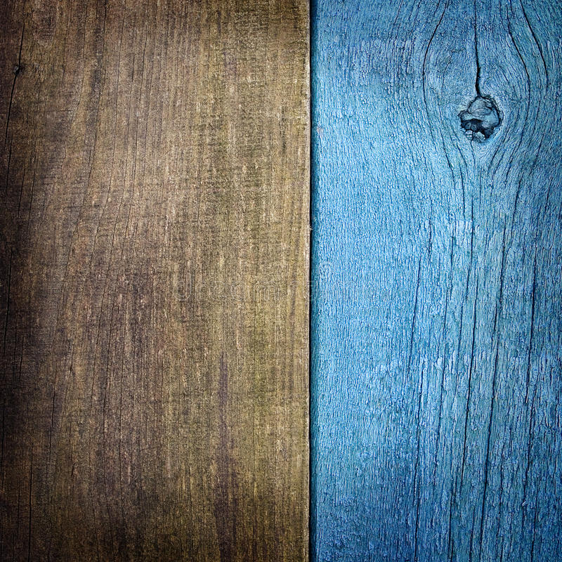 Old wooden background of two boards. Old wooden background of blue and brown boards stock photos