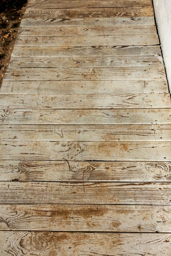 Old wooden background of white shabby painted wooden planks. Background of old painted texture wood as a basis for vintage. Creative design stock image