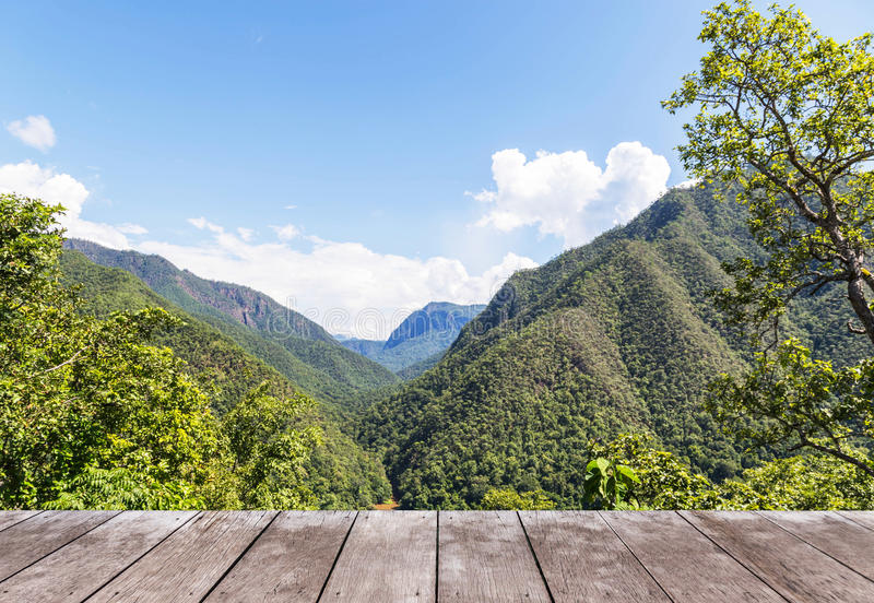 Old wooden balcony terrace on viewpoint high layer mountain of rainforest. Empty old wooden balcony terrace floor on viewpoint high tropical layer mountain of stock photography