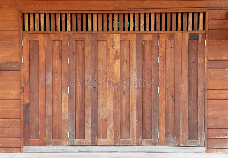 Old wooden barn door. Abandoned access antique architecture background barn broken brown building close cracked dirty door doorway entrance exterior farm gate stock photo