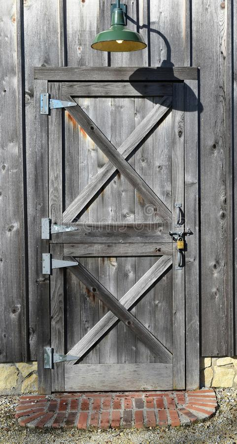 Old wooden barn door in a rustic farm building stock image