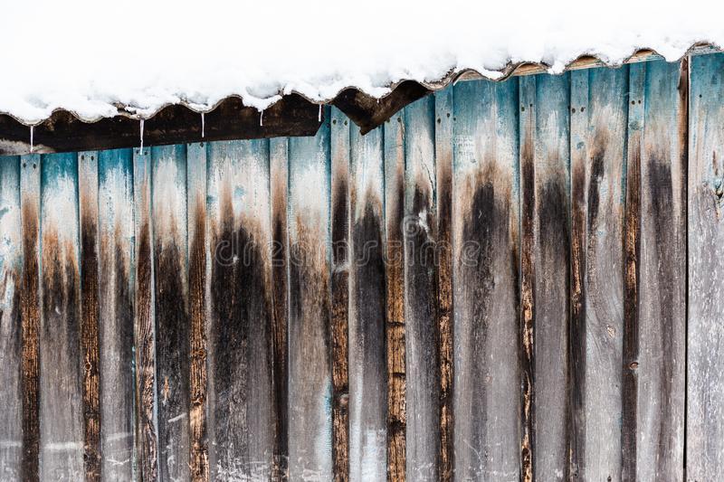 Old wooden barn planks wall winter texture and background.  stock image