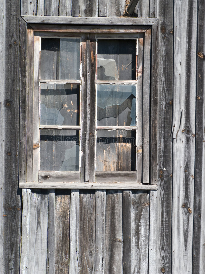 Old wooden barn window. With glasses cracked stock images