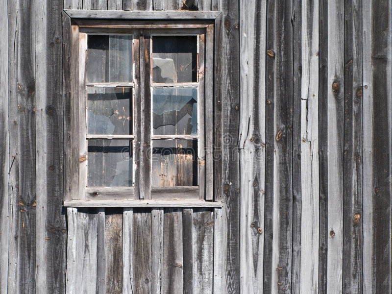 Old wooden barn window. With glasses cracked royalty free stock photos