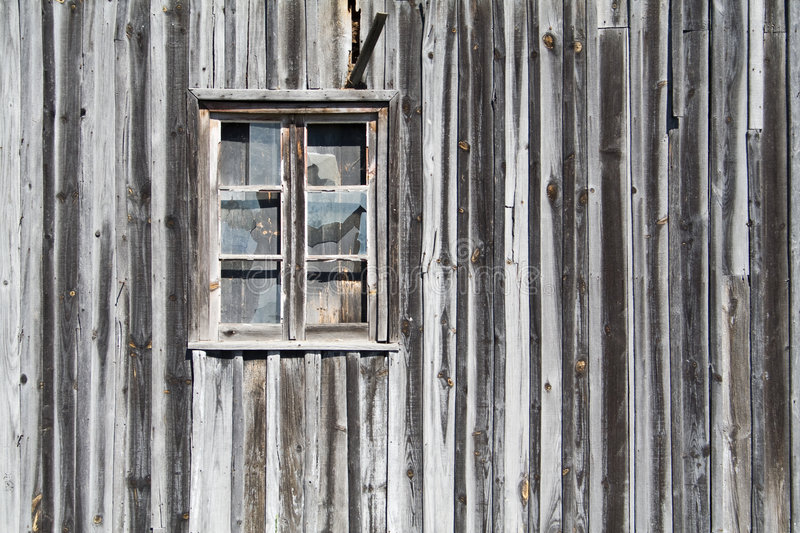 Old wooden barn window. With glasses cracked stock photos