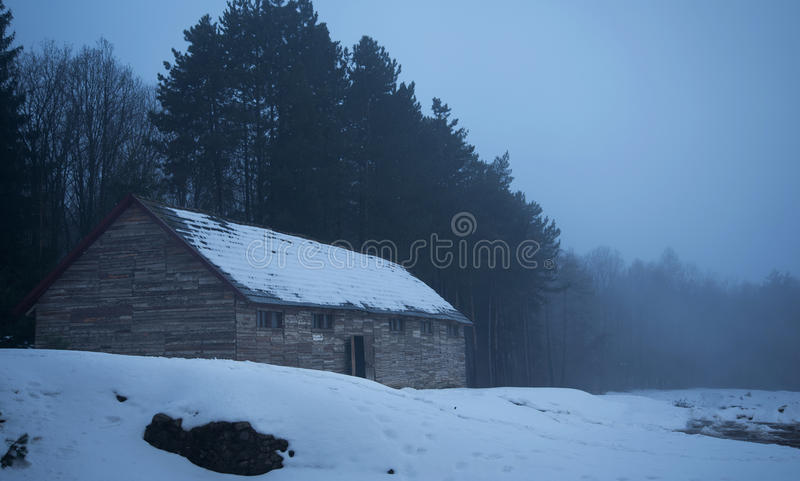 Old, wooden barrack in the forest. A winters day royalty free stock photos