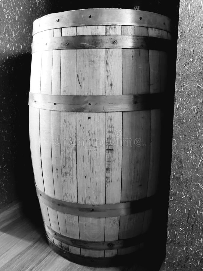 Old wooden barrel with metal strips. Antique, vintage, decorative, decoration, ornament, isolated, white, black, gray, object, recipient royalty free stock image