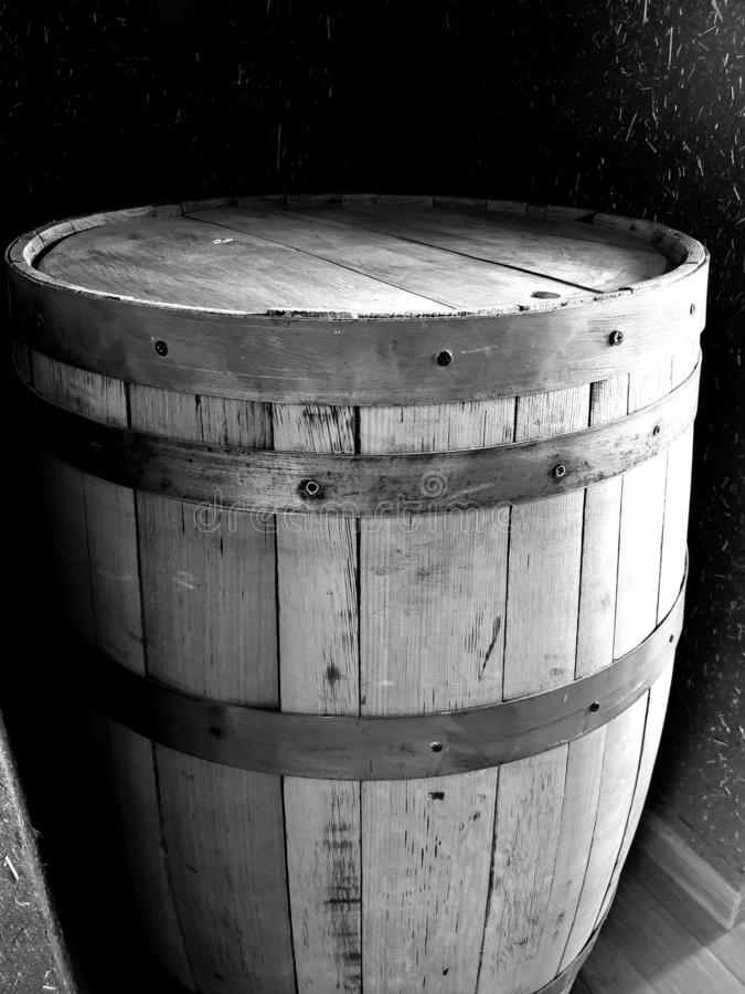 Old wooden barrel with metal strips. Antique, vintage, decorative, decoration, ornament, isolated, white, black, gray, object, recipient stock photography