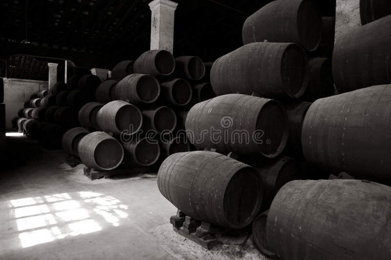 Old Wooden Barrels Of Sherry In Bodega Royalty Free Stock Photography