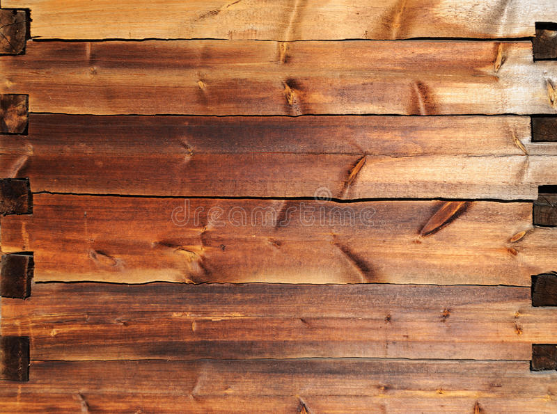 Old wooden beam jointed wall royalty free stock image