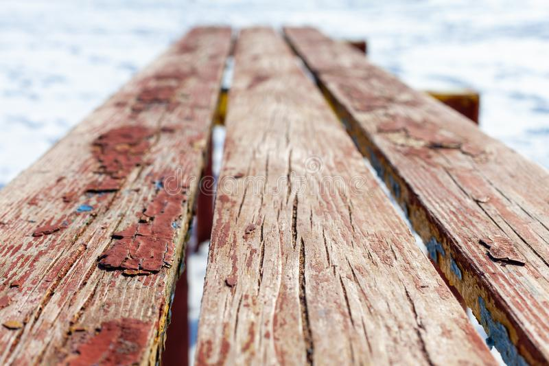 Old wooden bench perspective stock photo
