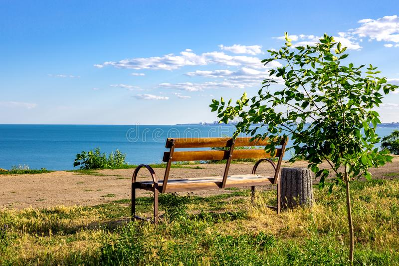 old wooden bench to rest on access to the beach, sunset at a beach of Baltic sea on summer evening royalty free stock image