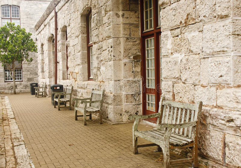 Download Old Wooden Benches Along Stone Block Wall Stock Image - Image of chair, stone: 23461839