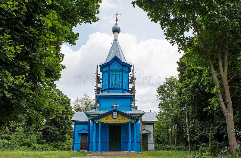 Old wooden blue christian church located in the village. In Ukraine royalty free stock photography