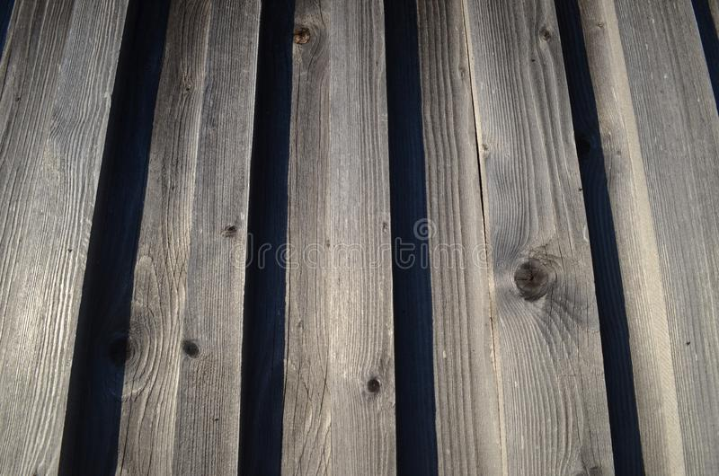 Old wooden board macro photo. Timber material photo background. Rustic wood backdrop. Countryside outdoor photo. Old wooden board macro photo. Timber material stock photos