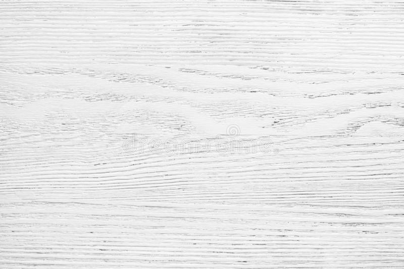 Old wooden board painted white.  Aged wood texture for background stock photography
