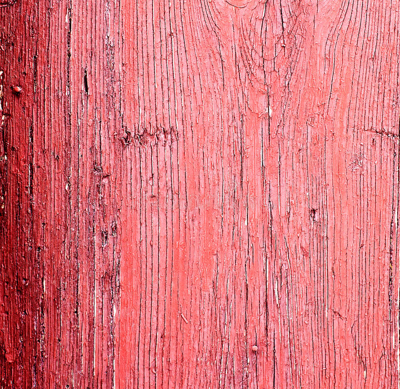 Old wooden boards painted pink paint,. The cracks in the rustic background stock photos