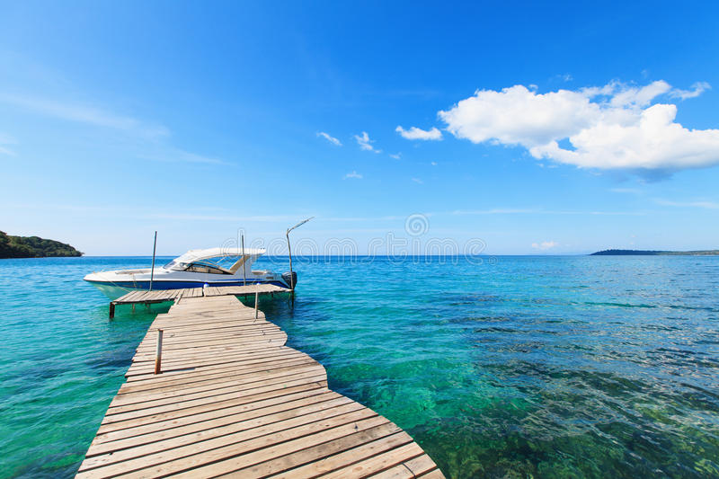Old Wooden Boat Dock, Going Far Out To Sea. Stock Photo - Image of ocean, sunny: 28446392