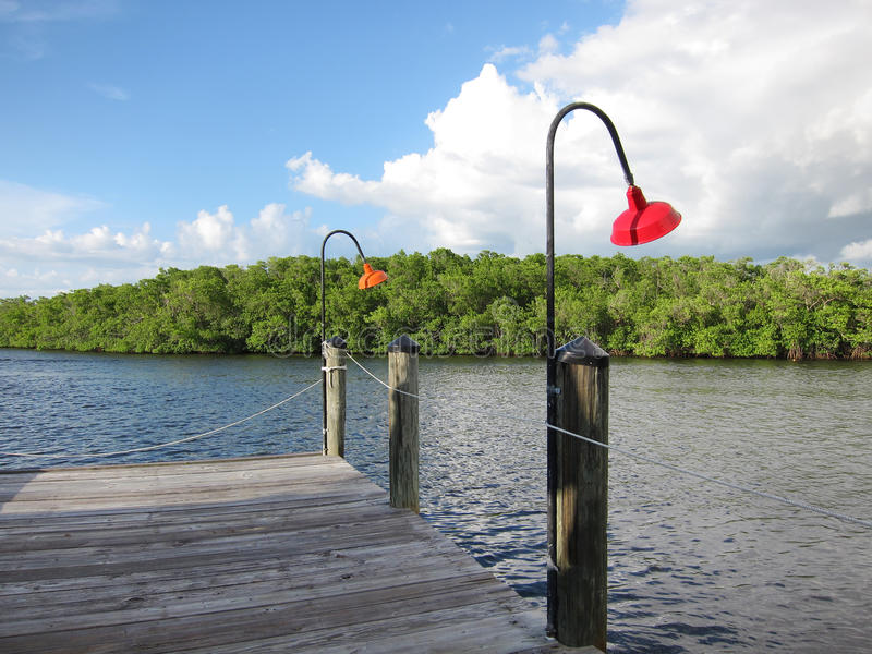 Old wooden boat dock in Naples Florida royalty free stock images